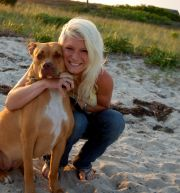 Phoenix Russell, a member of the Island Alpaca staff, and owner of Equine Natural Movement Series, with her dog, Luna.